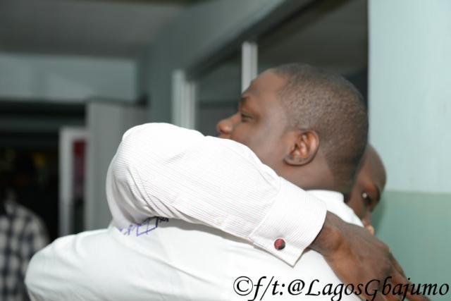 Tunde Leye hugs the winner Niyi Afolabi